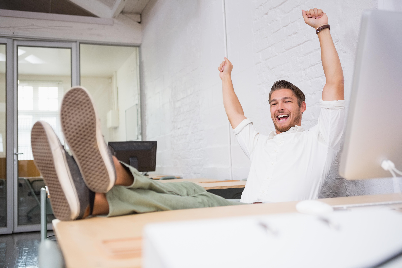life coach cheering at desk